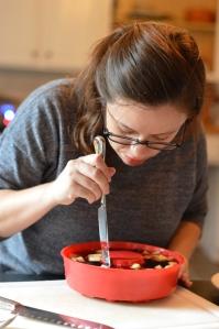 woman running knife around Jello mold