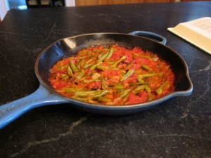 green beans and tomatoes in a skillet