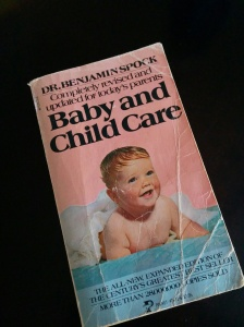 cover of the 1976 edition of Dr. Spock's baby and childcare, featuring a smiling baby